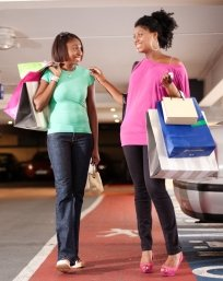 African American girlfriends with shopping bags