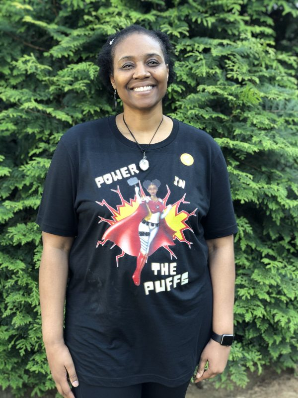 Alicia McCalla Wearing Power in the Puffs T-Shirt